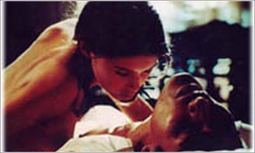 Jane March (la jóven) y Tony Leung (el amante chino)